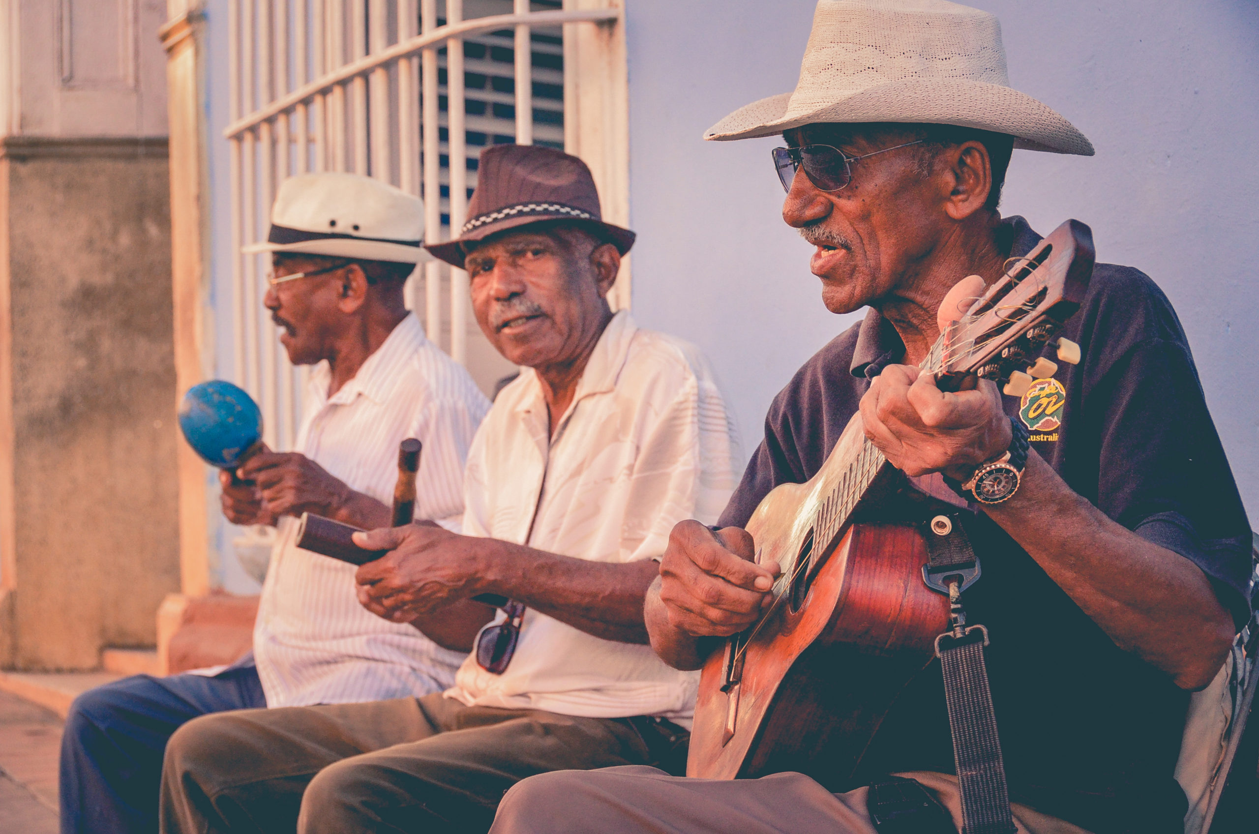 Canva — Three Men Playing Musical Instruments